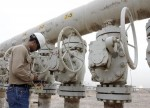 Crude oil settles lower as US production hits 2-year high