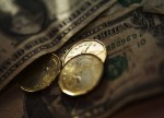 Forex - USD/CAD drops after U.S., Canadian data