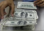 Forex - Dollar moves higher on March rate hike hopes