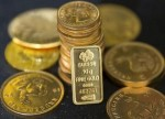Gold turns positive; Fed minutes eyed