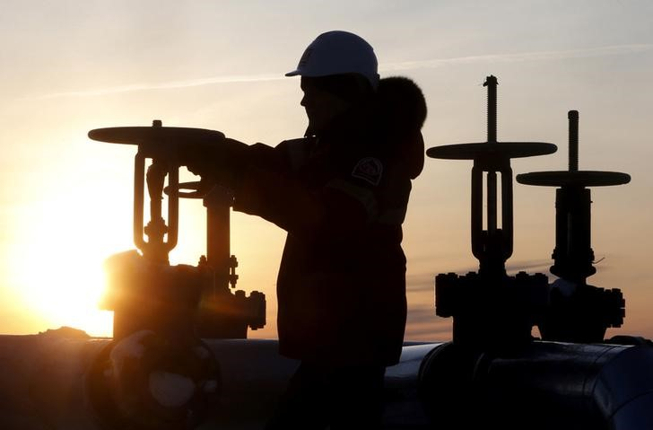 Oil prices edge up on weaker dollar, expected crude output cuts