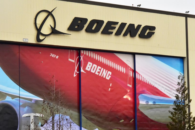 © Reuters. Boeing Co's logo is seen above the front doors of its largest jetliner factory in Everett